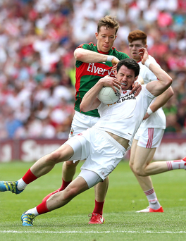 Closely marked: Tyrone's Mattie Donnelly is tackled by Mayo's Donal Vaughan at Croke Park