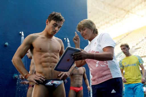 Action replay: Tom Daley watches a video replay of his dive with coach Jane Figueirdo during a training session in Rio