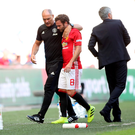Quick turnaround: Juan Mata walks past Jose Mourinho after being taken off with just 29 minutes of action under his belt