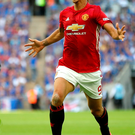 Euphoric: Zlatan Ibrahimovic marks scoring the winner for his new club