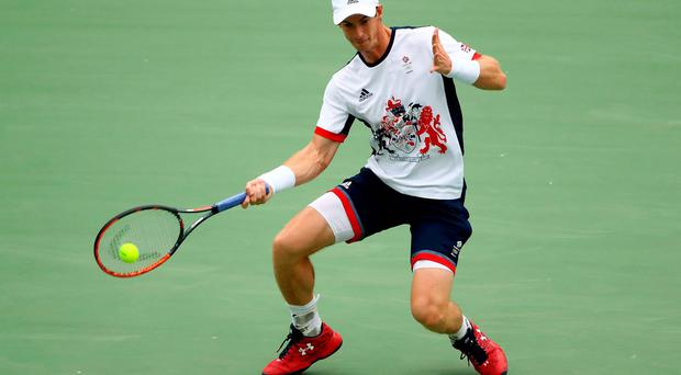 Early marker: Andy Murray got the ball rolling in his Olympic title defence with a comfortable 6-3 6-3 victory over Viktor Troicki in Rio