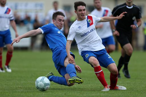 Tight tussle: Linfield's Paul Smyth and Ballinamallard's Ryan McConnell