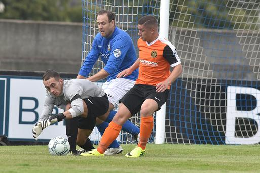 On the ball: Carrick's Brian Neeson pounces to deny Guy Bates possession