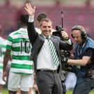 Wave to the crowd: Brendan Rodgers acknowledges the Celtic fans after winning his first league game in charge of the Bhoys