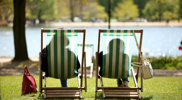 Households made the most of the warmer weather in July by spending more on new clothes, meals out and day trips, a report has found