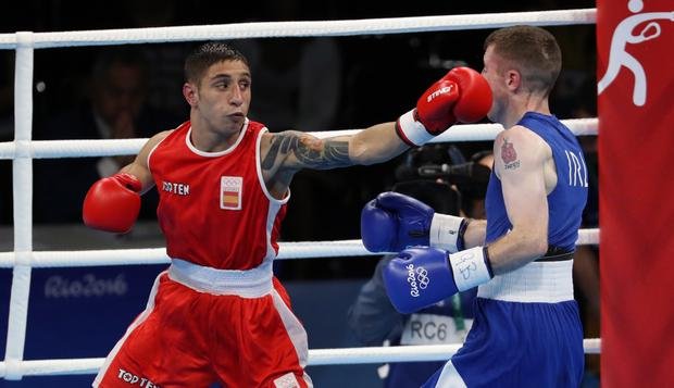 Ireland's Paddy Barnes with Samuel Carmona Heredia of Spain in the Men's Light Flyweight 49kg Round of 16. Image: INPHO/Dan Sheridan