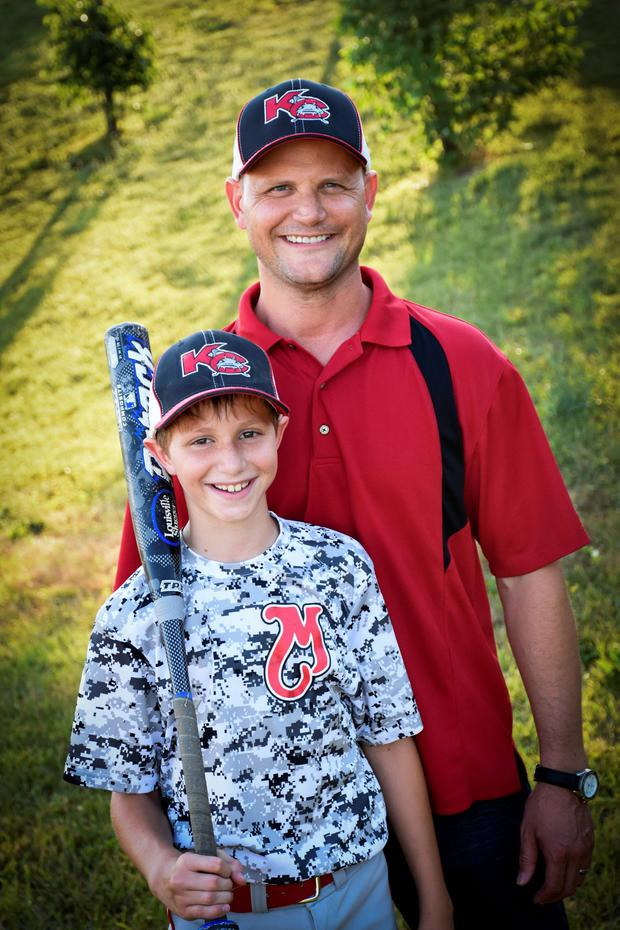 This June 2016 photo provided by David Strickland shows Caleb Thomas Schwab posing with his father Scott Schwab, a Kansas state lawmaker from Olathe. (David Strickland/David Strickland via AP)