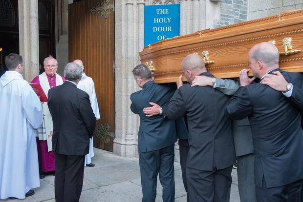 Bishop Donal McKeown with the remains of the late Bishop Edward Daly which were brought to St. Eugene's Cathedral in Derry on Monday evening, where they will remain until Requiem Mass on Thursday afternoon and burial in the grounds of the Cathedral. Picture Martin McKeown. Inpresspics.com. 08.08.16