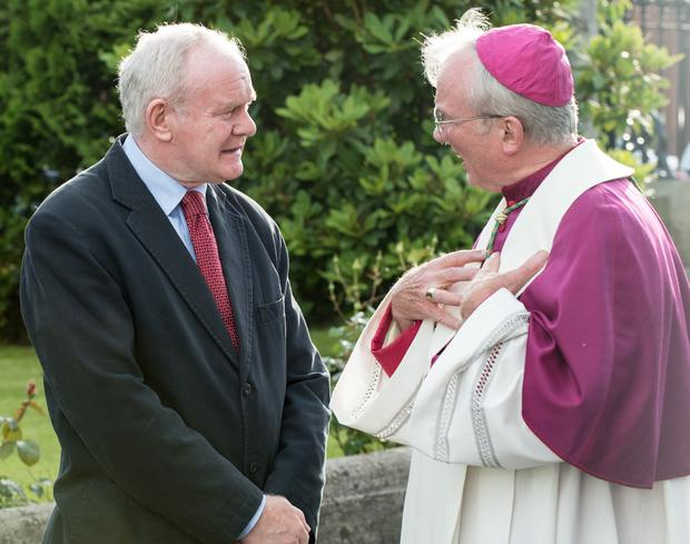Deputy First Minister Martin McGuinness with Bishop Donal McKeown at St. Eugene's Cathedral where the remains of Bishop Edward Daly were brought on Monday evening. Picture Martin McKeown. Inpresspics.com. 08.08.16
