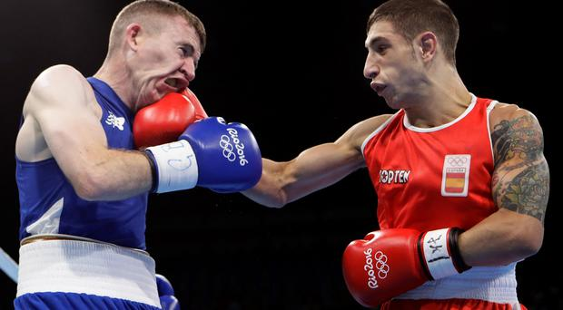 Painful: Paddy Barnes ships a punch from Samuel Carmona Heredia