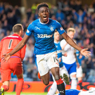 Go Joe: Joe Dodoo celebrates scoring Rangers' fifth goal against Peterhead at Ibrox last night