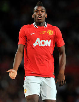 Different shade of Red: Paul Pogba joined United as a 16-year-old in 2009 instead of Arsenal