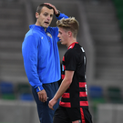 Away day blues: Coleraine's Oran Kearney reacts as Lyndon Kane is sent off during last night's clash at Windsor Park