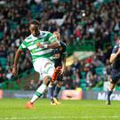 Spot on: Celtic's Moussa Dembele scores his side's second goal of the game from the penalty spot