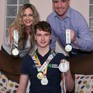 New start: Swimmer Conor Ferguson with his Mum and Dad, Patricia and Peter