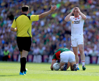 Turning point: Tyrone's Sean Cavanagh is sent off for a challenge on Aidan O'Shea in the defeat to Mayo