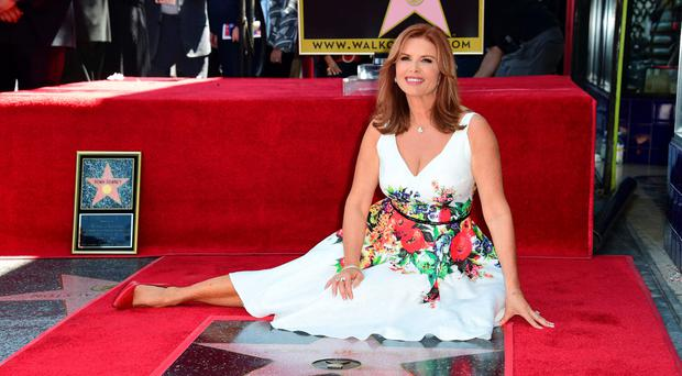 Actress Roma Downey (R) poses with her daughter Reilly Marie Downey Anspaugh on her star on the Hollywood Walk of Fame during the star presentation ceremony August 11, 2016 in Hollywood, California. / AFP PHOTO / Robyn BECKROBYN BECK/AFP/Getty Images