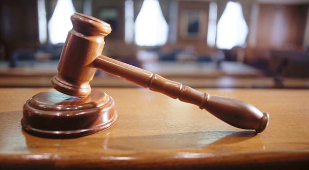 A Co Armagh man accused of attacking and threatening to kill his partner fell and broke his foot as he tried to climb back into her home, the High Court heard today.