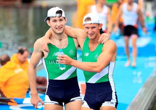 Ireland's Gary O'Donovan (right) and Paul O'Donovan (left) celebrate winning silver in the Lightweight Men's Double Sculls Final at The Lagoa Stadium on the seventh day of the Rio Olympic Games, Brazil. Picture date: Friday August 12, 2016. Photo credit should read: Mike Egerton/PA Wire. RESTRICTIONS - Editorial Use Only.