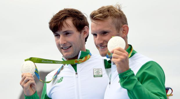 Ireland's Gary O'donovan (L) and Paul O'donovan pose with their medals on the podium of the LWT Men's Double Sculls final rowing competition at the Lagoa stadium during the Rio 2016 Olympic Games in Rio de Janeiro on August 12, 2016. / AFP PHOTO / Damien MEYERDAMIEN MEYER/AFP/Getty Images