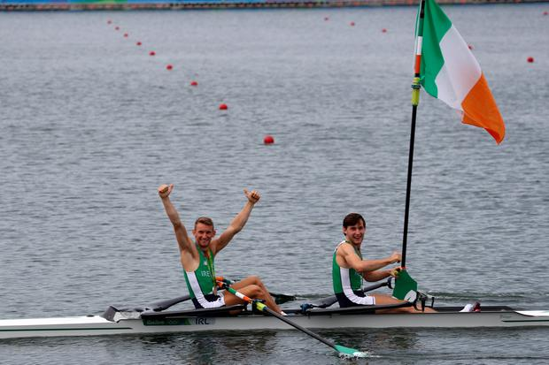 RIO DE JANEIRO, BRAZIL - AUGUST 12: Silver medalists Paul O'Donovan (R) and Gary O'Donovan (L) of Ireland celebrate on their boat after the medal ceremony for the Lightweight Men's Double Sculls on Day 7 of the Rio 2016 Olympic Games at Lagoa Stadium on August 12, 2016 in Rio de Janeiro, Brazil. (Photo by Phil Walter/Getty Images)