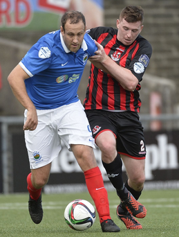 Man on: Billy Joe Burns challenges Guy Bates during Linfield's visit to Seaview last September