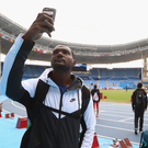 In the picture: Justin Gatlin, who is Usain Bolt's main rival, looks around the Olympic Stadium in Rio