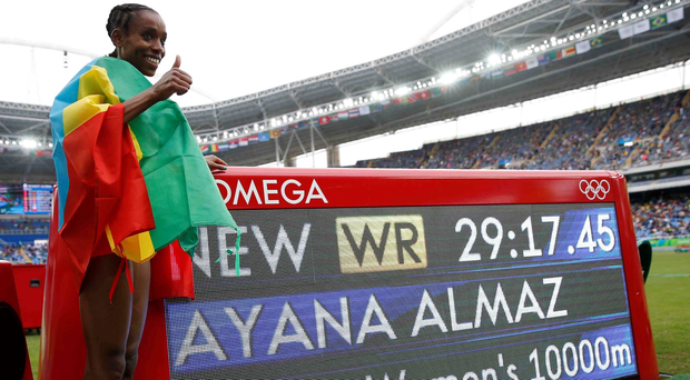 Thumbs up: Almaz Ayana celebrates taking more than 14 seconds off the 10,000m world record but the manner of her victory has raised eyebrows