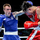 Big impact: Ballymena's Steven Donnelly lands a blow during his split decision victory over Tuvshinbat Byambyn of Mongolia