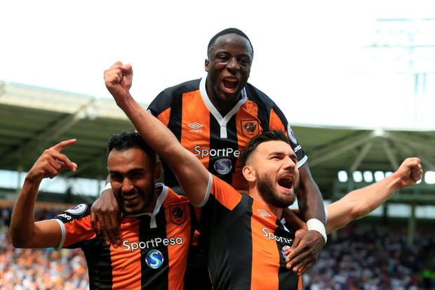 Hull City's Scottish midfielder Robert Snodgrass celebrates with Hull City's Egyptian midfielder Ahmed Elmohamady and Hull City's Norwegian striker Adama Diomande LINDSEY PARNABY  AFP  Getty Images