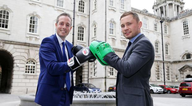 Sports Minister Paul Givan pictured with two time world champion Carl Frampton to announce a funding package of up to £200,000 to help a number of amateur boxing clubs carry out capital works to improve their premises. Photo by Kelvin Boyes / Press Eye