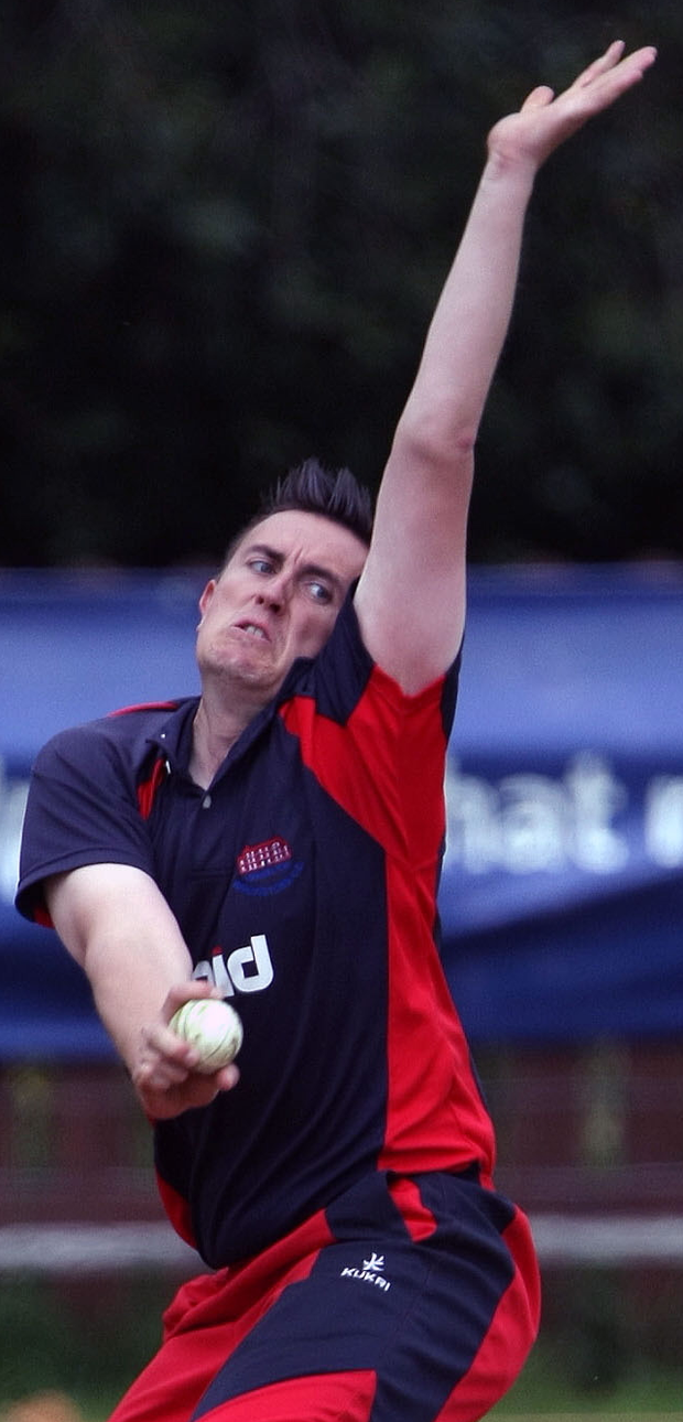 Powerhouse: Waringstown captain Lee Nelson bowling in his side's Irish Cup victory over Instonians