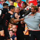 Party time: Liverpool players celebrate their victory with manager Jurgen Klopp