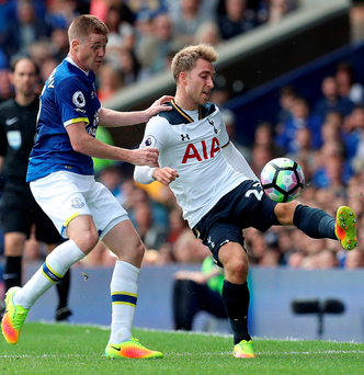 Close contact: Everton's James McCathy (left) and Tottenham Hotspur's Christian Eriksen (right) battle for the ball