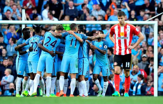 Nightmare: City celebrate the own goal by Paddy McNair (right)