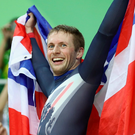 Five alive: Jason Kenny hoists the Union flag after his victory
