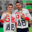 Great Britain's medalists Max Whitlock (left, gold) and Louis Smith (right, silver) following the men's Pommel Horse final in Rio