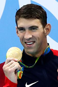 Greating ending: Michael Phelps hold up his 23rd, and final, gold medal
