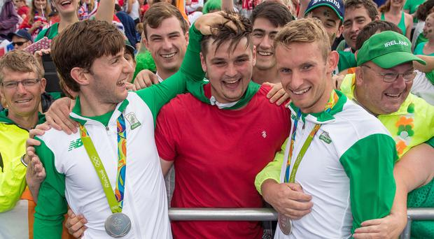Moment to cherish: Ireland's Paul and Gary O'Donovan celebrate winning a silver medal with childhood rowing friend Diarmuid O'Driscoll in the Men's Lightweight Double Sculls Final