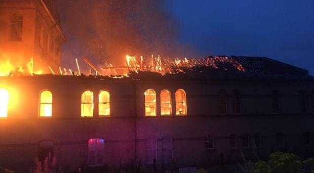 Firefighters at the Herdman's Mill blaze. Pic NIFRS West