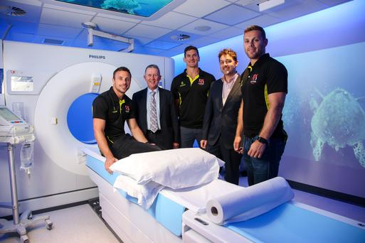 Pictured at the official launch of world-leading CT technology at the Ulster Independent Clinic are Ulster and Ireland Rugby players Tommy Bowe, Robbie Diack and Darren Cave along with Chairman of the Ulster Independent Clinic, Dr Kieran Fitzpatrick (second left) and Consultant Radiologist Dr Peter Ball (second right)