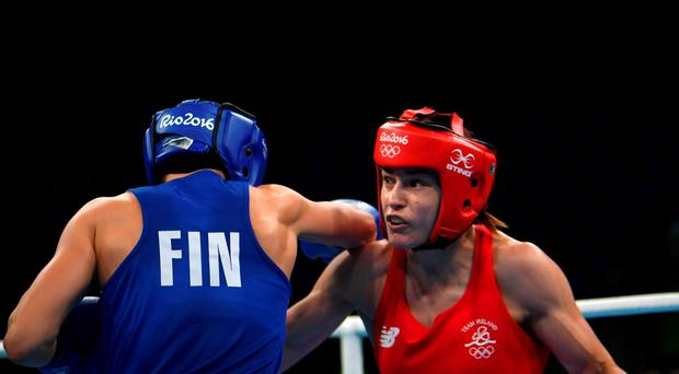 Ireland's Katie Taylor (R) fights Finland's Mira Potkonen during the Women's Light (57-60kg) Quarterfinal 1 match at the Rio 2016 Olympic Games at the Riocentro - Pavilion 6 in Rio de Janeiro on August 15, 2016. / AFP PHOTO / Yuri CORTEZYURI CORTEZ/AFP/Getty Images