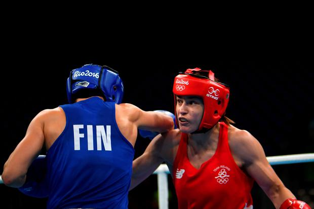 Ireland's Katie Taylor (R) fights Finland's Mira Potkonen during the Women's Light (57-60kg) Quarterfinal 1 match at the Rio 2016 Olympic Games at the Riocentro - Pavilion 6 in Rio de Janeiro on August 15, 2016. AFP/Getty Images