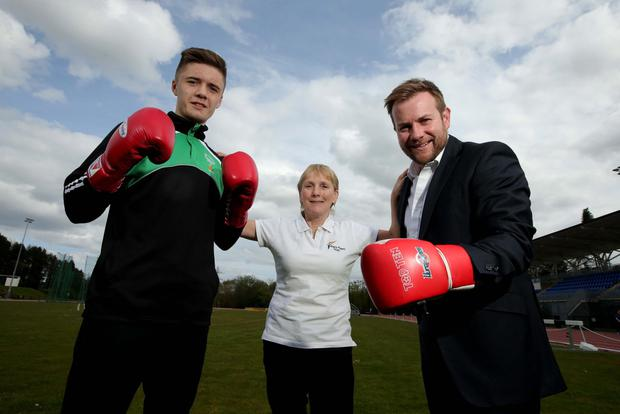 Packing a Punch: Rainbow award winner Kane Tucker (left), with Eilish Rutherford, Chair of the Mary Peters Trust and Stuart Carson, Sales and Marketing Director, Rainbow Communications