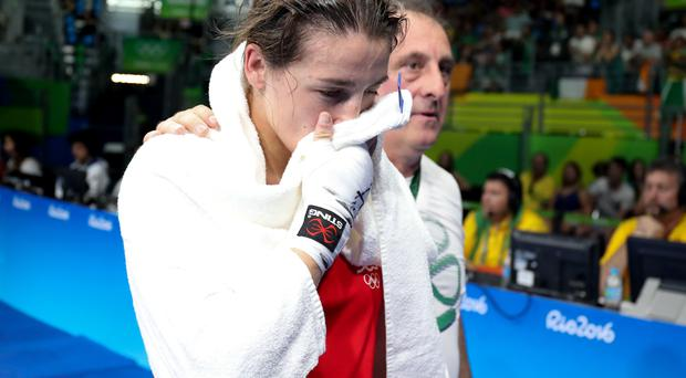 Disbelief: Katie Taylor is stunned after losing her lightweight quarter-final on a split decision to Mira Potkonen in Rio yesterday
