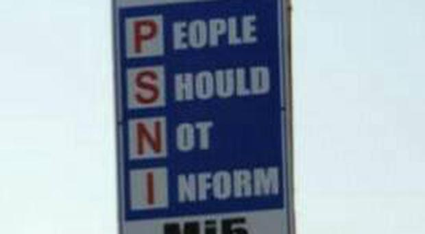 Police have hit back after posters appeared on lamp posts warning people not to talk to the PSNI