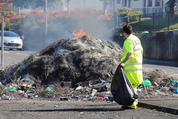 The remains of last night's bonfire at the bottom of the Flyover on the Lecky Road, Derry. Mandatory Credit Photo Lorcan Doherty / Presseye.com