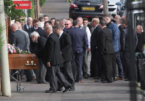 Family and friends look on as Boreland's coffin is taken into Cliftonville Moravian Church on the Oldpark Road for his funeral service. Picture: Sunday Life.