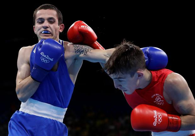 Armenia's Aram Avagyan, left, and Ireland's Michael John Conlan exchange punches during a men's bantamweight 56-kg preliminary boxing match at the 2016 Summer Olympics in Rio de Janeiro, Brazil, Sunday, Aug. 14, 2016. (AP Photo/Frank Franklin II)