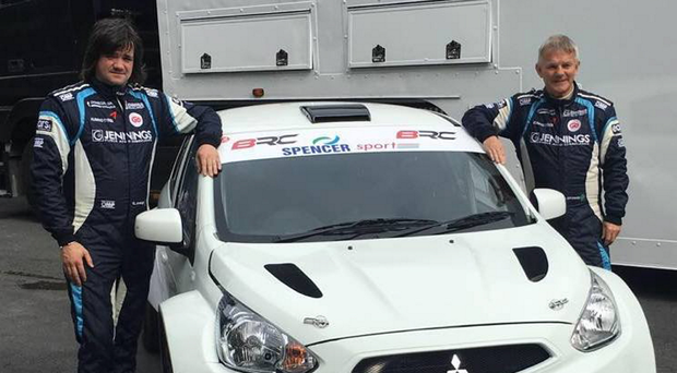 New wheels: Garry Jennings and co-driver Rory Kennedy with the Mitsubishi Mirage they will use in the Ulster Rally